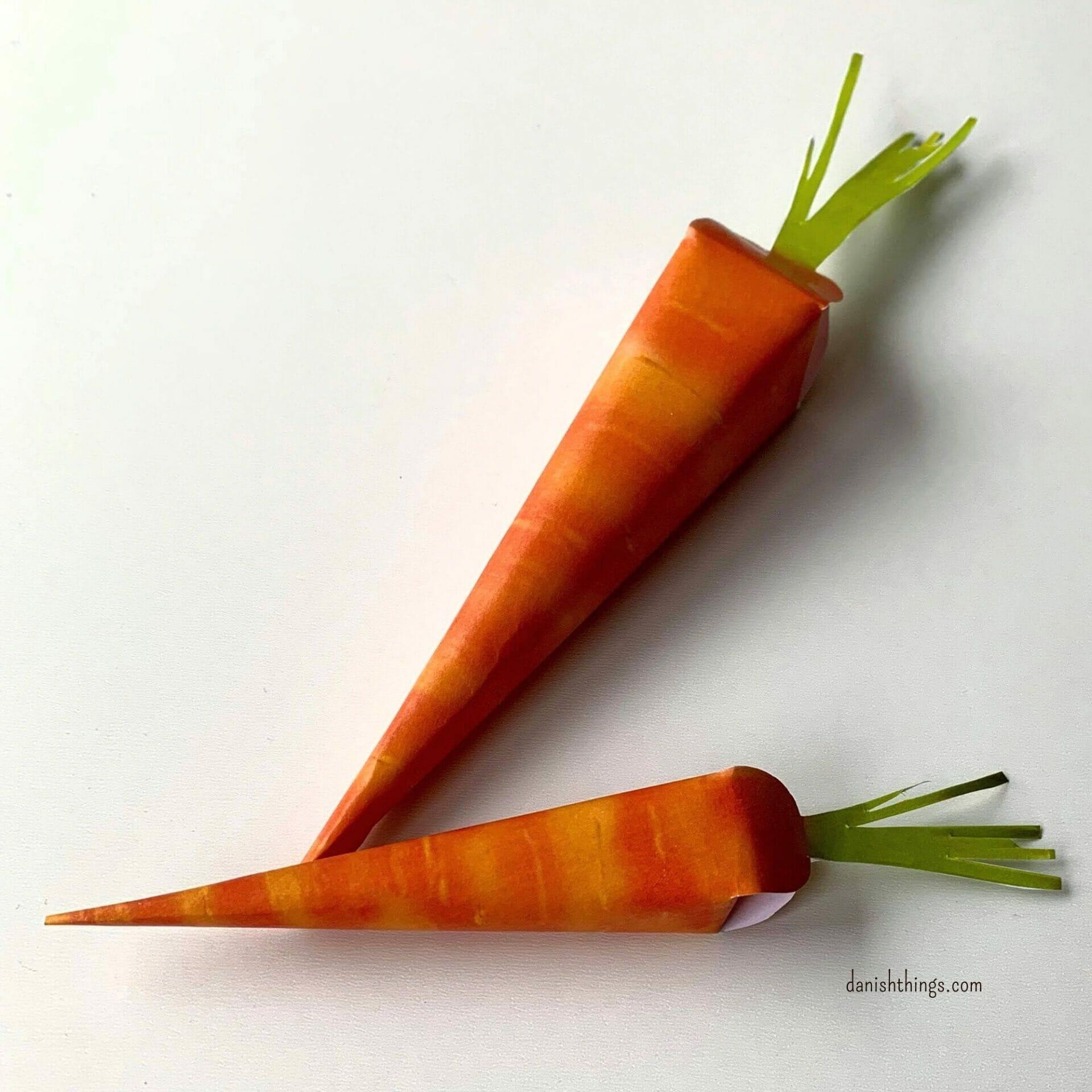 Gulerod af papir. Lav små eller store gulerødder af papir. Brug dem som dekoration på dit frokostbord, eller som en lille gaveæske - f.eks. som et anderledes påskeæg. Find opskrifter, gratis print og inspiration til årets gang på danishthings.com #DanishThings #gulerod #gulerødder #papir #æske #lavselv #gratis #print #gave #dekoration #påske #påskefrokost #påskeæg #forår #sommer #høstfest #efterår